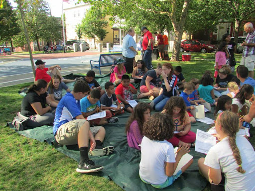 After the Kid's Bible Club, the teens from the Mission Trip help the kids with their Bible worksheets.