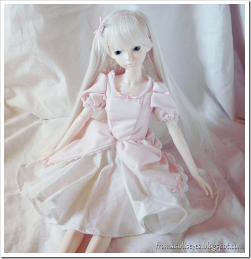 Ball Jointed Doll Showing off Her New Pink Dress