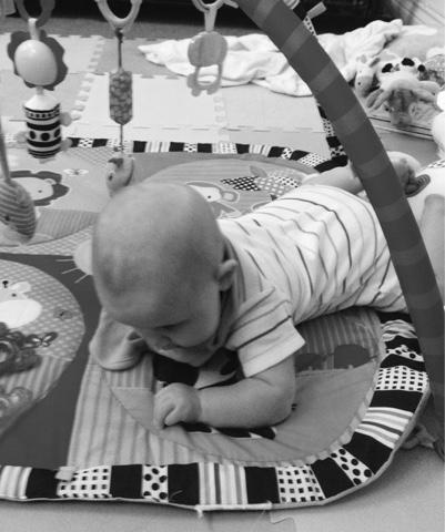 baby on tummy - 4 months
