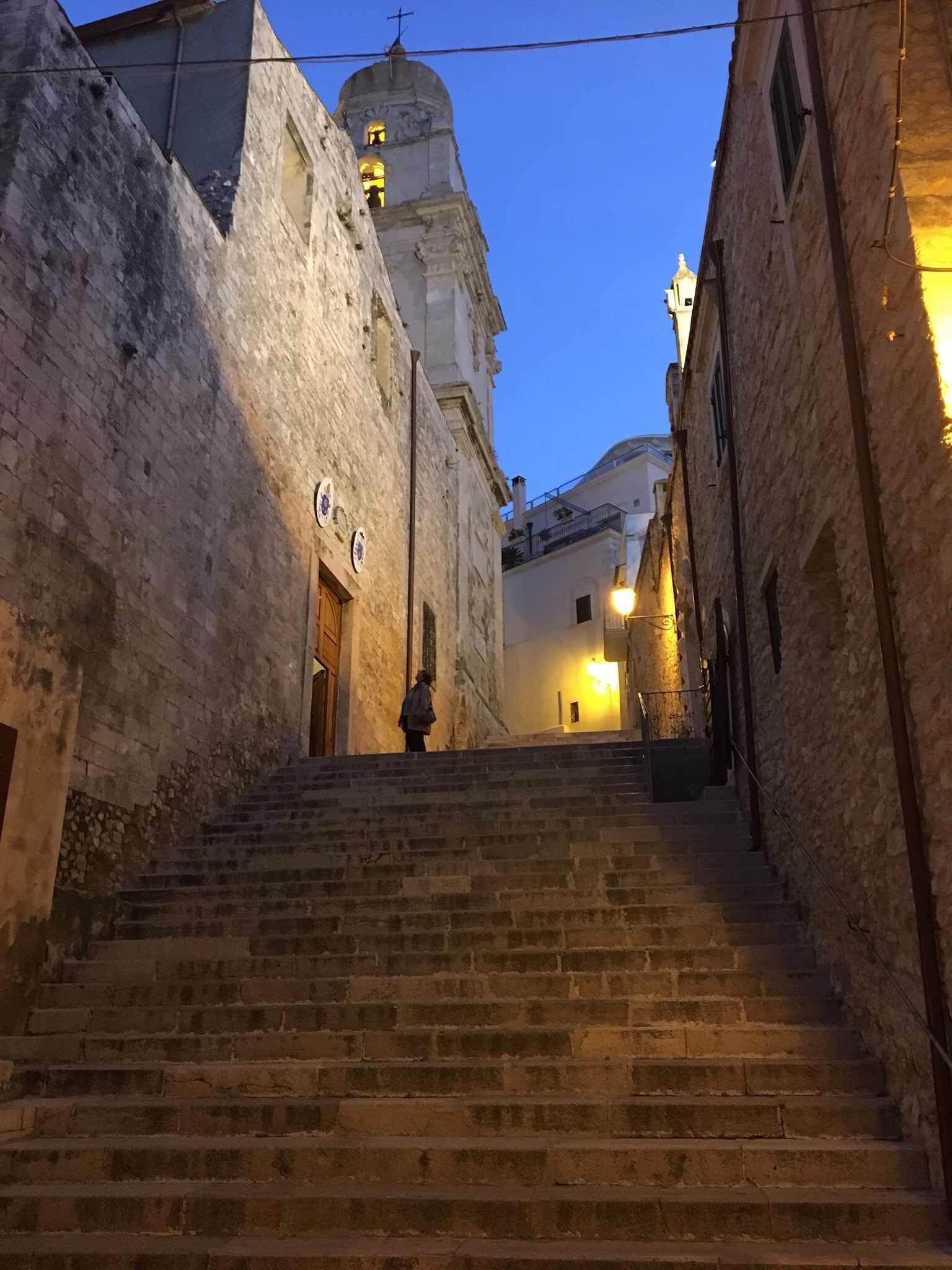 street lights, ancient stone stairs and walls in Vieste, Italy