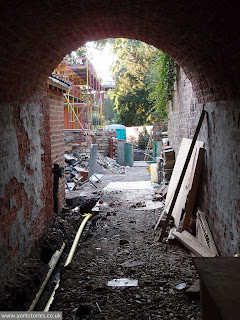 That archway previously pictured, gate always closed. Now opened up. Looking towards the back of the engine house development, the new extension, Aug 2013
