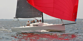 J/88 family speedster sailboat under spinnaker