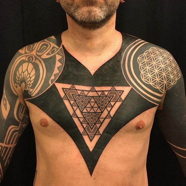 Incredible-geometric-chest-and-sleeve-tattoo-tattoo-designs-for-men-900x900