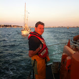 Crew Member Alex Evans taking time out to pose for a photo while monitoring the tow of a 9.5m motor sailing vessel that had overheated. 19 August 2013 Photo: RNLI/Dave Riley