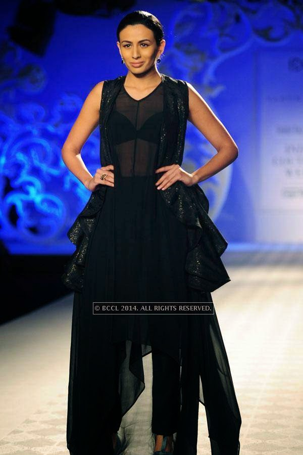 A model walks the ramp for Varun Bahl walks the ramp on Day 3 of India Couture Week, 2014, held at Taj Palace hotel, New Delhi.<br />