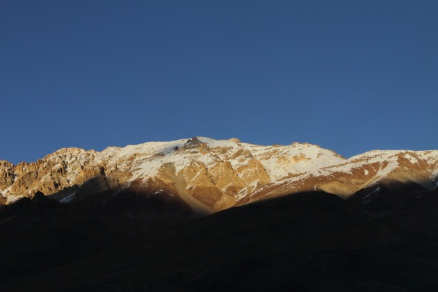 Sunset over snowy Himalayas in the Chandra Bhaga range, Himachal Pradesh