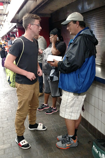 Because of rain, the Team from Maine got to experience subway evangelism. In this photo, Joshua gave a Bible to Danny, who wanted to know how to be born-again.