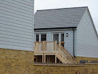 External stairs and landings in softwood with Iroko treads, half risers and handrails