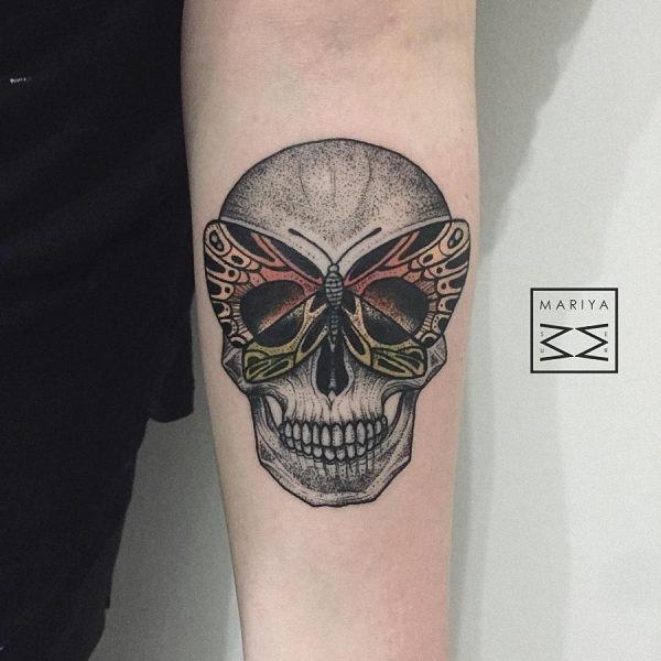 este_alucinante_crnio_e_tatuagem_de_borboleta