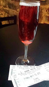 Cocktail of Roxane with Campo Viejo Cava Brut Rose, St Germaine Elderflower Liqueur,  and Peychaud's Bitters sugar cube at the Portland Center Stage production of Cyrano