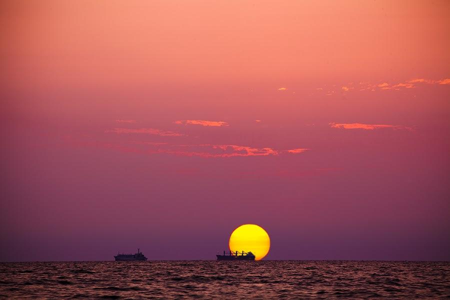 Sunrise by Robert Luca - Landscapes Sunsets & Sunrises ( orange, black sea, red, purple, blue, ship, sunrise )