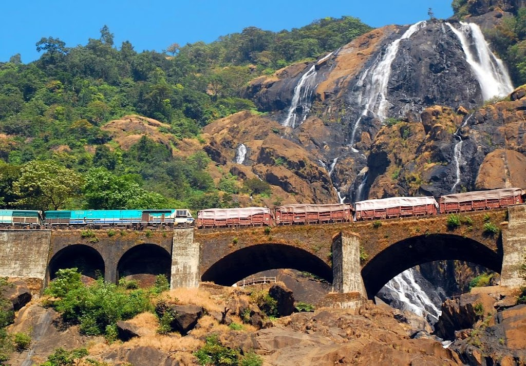 Train Crossing Bridge with Dudhsagar Waterfalls background