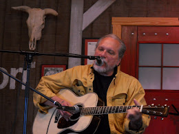 Jorma Kaukonen plays a song at the student performance.