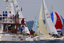 J/24s finishing sailboat race off Seattle, WA