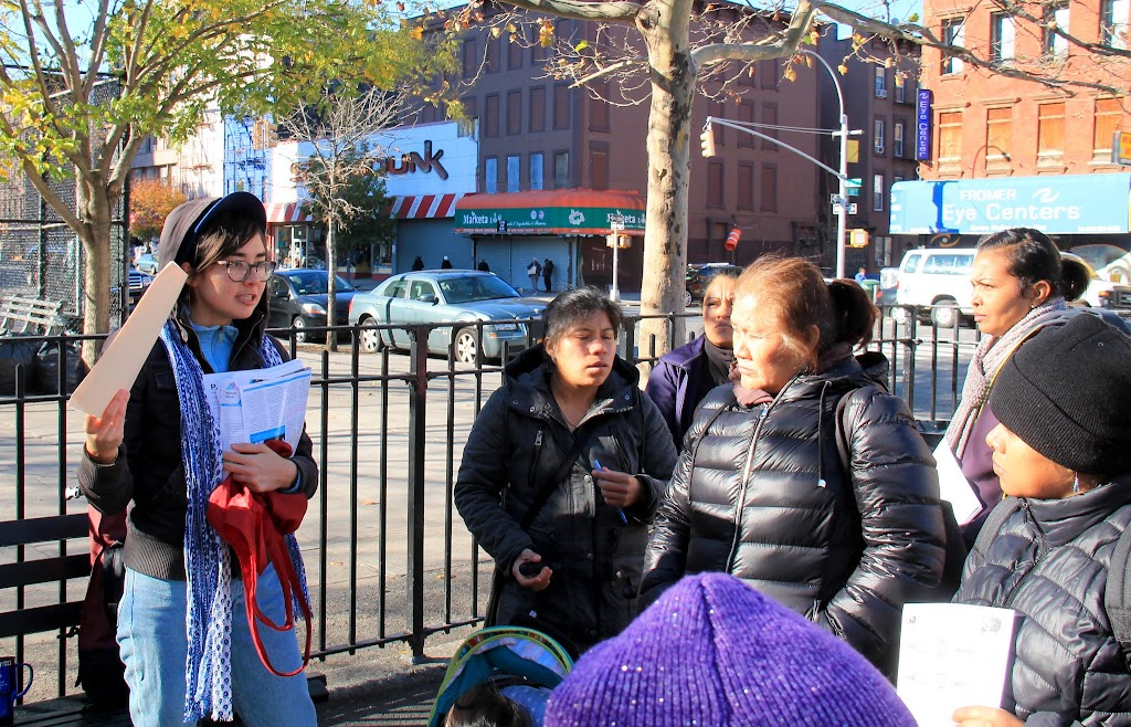 Emma tells families about the petition to save Chenchita's Community Garden