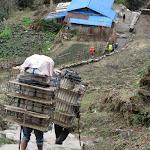 Porters hauling an empty load