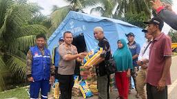 Kapolres Tebo Tinjau dan Berikan Sembako ke Warga Terkena Banjir