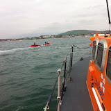 20 May 2012: Poole all-weather lifeboat escorting a dingy and sailing club safety boat after the dinghy had capsized on Peveril Ledge. Photo: RNLI/Poole Dave Riley