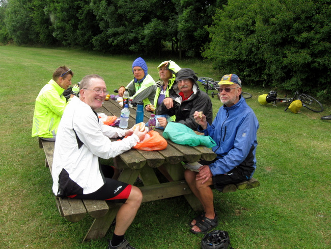 Group at picnic table in waterproofs