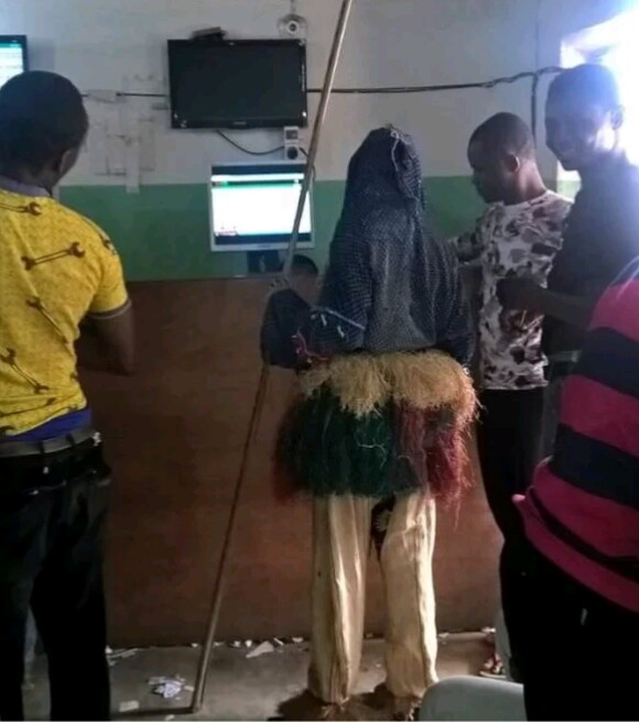 Masquerade Was Spotted Inside A Bet9ja Shop Checking His Betslip
