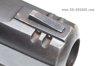 Photo: Now the front sight. It is held in place with two tiny roll pins.