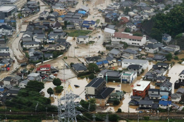 Aerial view of flooded houses in Japan's Hiroshima prefecture, 7 July 2018. Photo: AFP Photo / STR