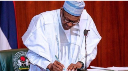President signing the document