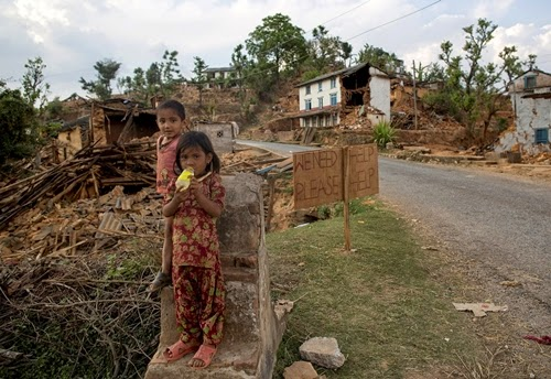Children stand on a structure of a collapsed house next to signage in a village after an earthquake in Sindhupalchowk Nepal May 2 2015 Bureaucracy at Kathmandu airport was holding up vital relief supplies for survivors of the April 25 earthquake in Nepal as the death toll from the disaster passed 6600 REUTERSDanish Siddiqui TPX IMAGES OF THE DAY