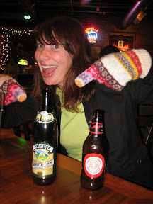 Kelly, pointing to her beer. Mine's on the right. The humor is really too obvious for a joke.