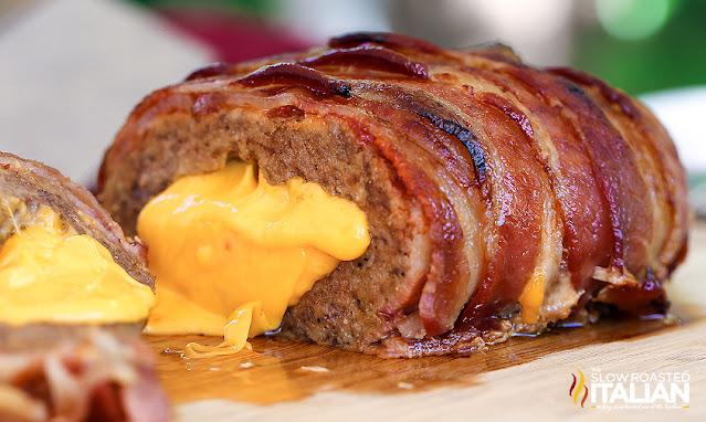 stuffed meatloaf on a cutting board