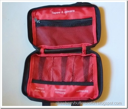 The inside of the the first aid kit case, there are several built in pockets and a zippered one.