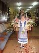Traje regional y medalla como Dama de la Virgen de la Victoria