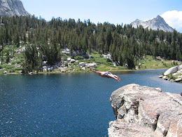 Cliff diving at Booth lake. Vogelsang peak in the distance.