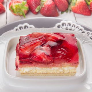 Layered Vanilla Pudding Cake with Berry-Filled Jello Topping.