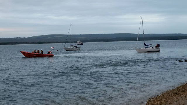 Poole ILB frees a grounded yacht in Poole Harbour - 5 August 2015.  Photo credit: Don Williams