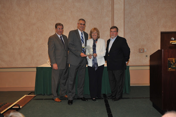 Dr. Komron Ostovar and Lorraine Stubley from Bassett Medical Center accept the 2011 Pinnacle Award for Quality and Patient Safety (Large Hospital category). Handing out the award are HANYS President Daniel Sisto (far left) and Joseph McDonald, President and Chief Executive Officer of Catholic Health System (far right).