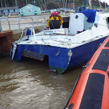 ILB crew secure the catamaran to the moorings at Rockley - 24 December 2013.  Photo credit: RNLI/Poole