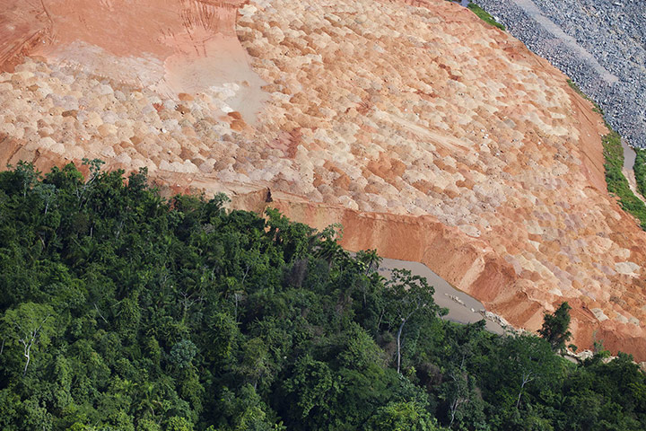 But indigenous and environmental groups, among others, counter that Belo Monte will displace tens of thousands of river-dwellers and bring violence, social chaos and environmental destruction – including deforestation – to the Amazon state of Pará. Photograph: Daniel Beltrá/Greenpeace