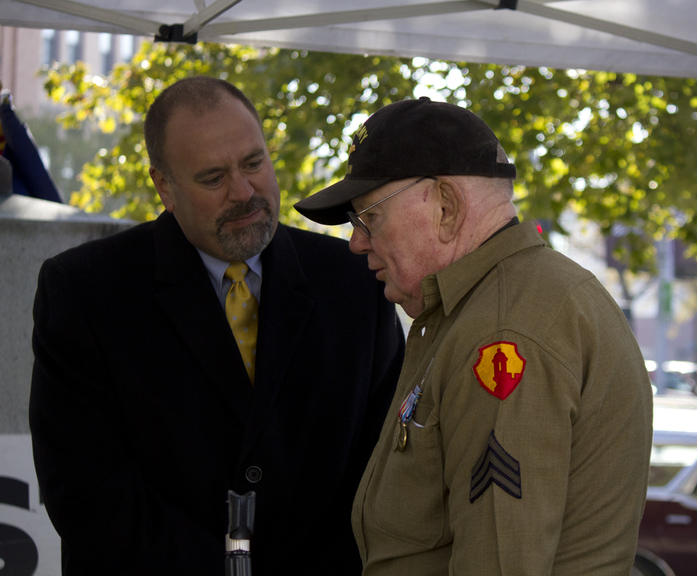Mayor John Engen shakes the hand of Bill McDaniel and thanks him for his service Friday morning. McDaniel, 88, fought in World War II. Photo by Caitlyn Walsh.