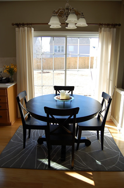 rug with an impressive dining table under the dining table