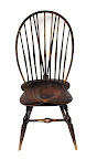 braced bowback side chair with worn brown paint