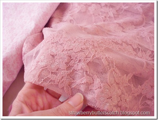 Pink allover lace fabric.