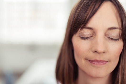 Face of a Reflective Adult Woman with Eyes Closed