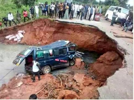 Road Divides Into Two Leaving Passengers Stranded In Benue Flood (Photos)