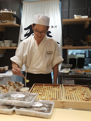 Diners can sit at the counter to watch the chef preparing tendon.