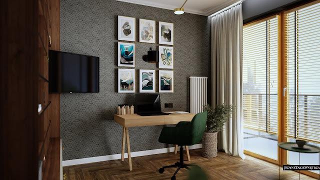 Eklektyczny gabinet do pracy, w którym znajduje się drewniane biurko z laptopem, a w tle geometryczna, szara tapeta.