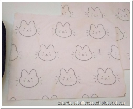 Close up of the cute fabric, it's a pink flannel with kawaii bunnies all over.
