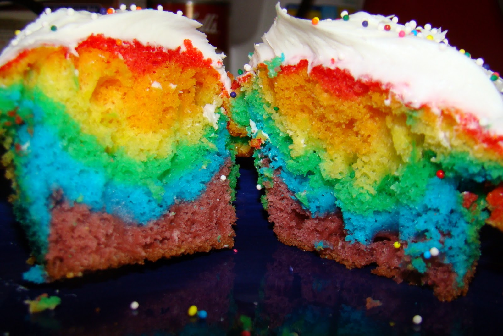 sitting at our kitchen table rainbow cupcakes