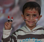 "The writing on Abdullah's forehead says: ""Together we build Yemen"",  Change Square, Sana'a, Yemen. ساحة التغيير بصنعاء اليمن"