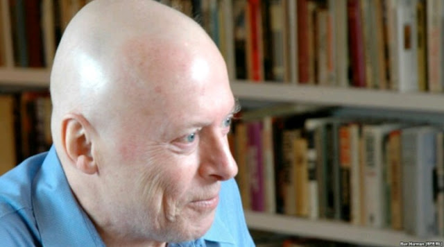 Christopher Hitchens, bald, smiling